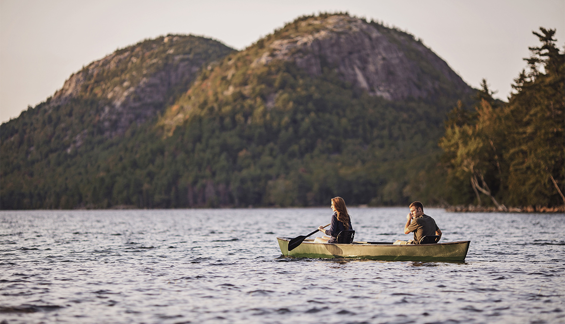 item 3 of Gallery image - a couple canoes along Jordan Pond in Acadia National Park