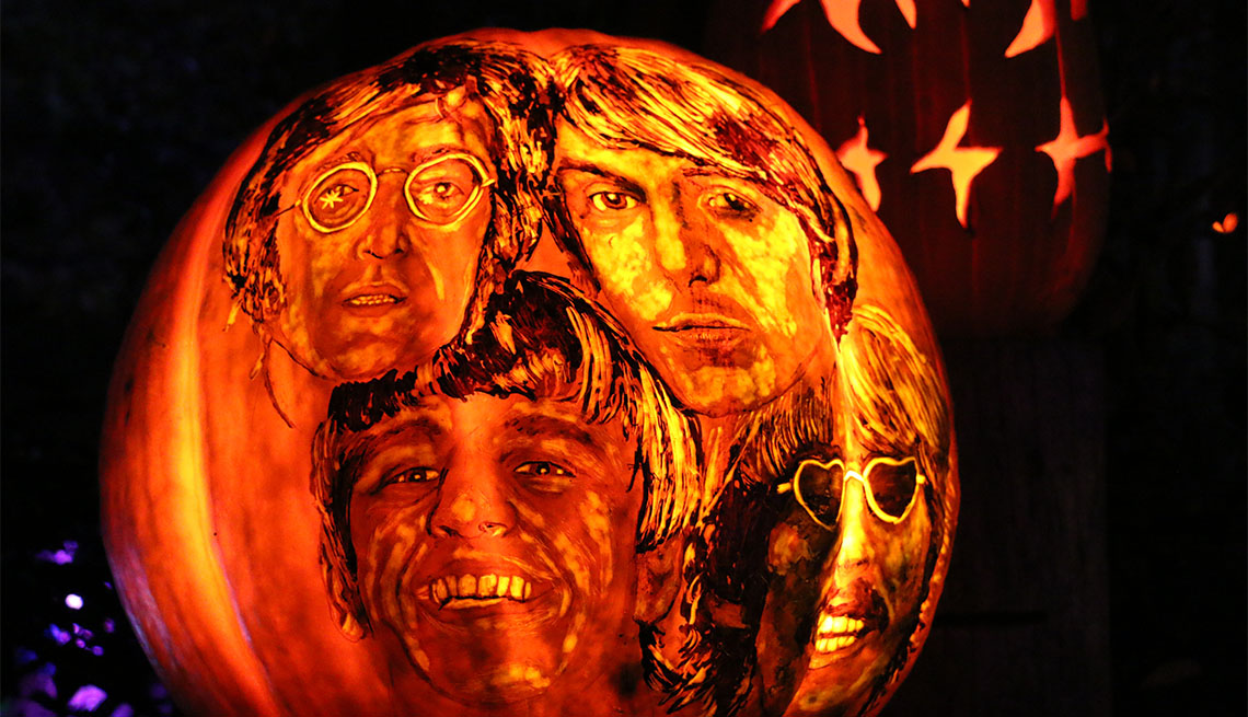 item 2 of Gallery image - The Beatles displayed on pumpkin at the Jack-O-Lantern Spectacular