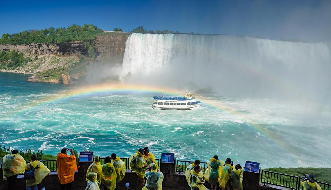 Tourists and visitors experience the Journey Behind the Falls, Ontario, Canada