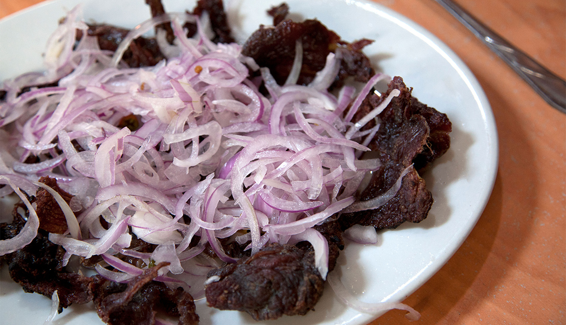 item 3 of Gallery image - Carne Seca, or dried beef, at a traditional picanteria in Ferranafe near the northern coastal city of Chiclayo.