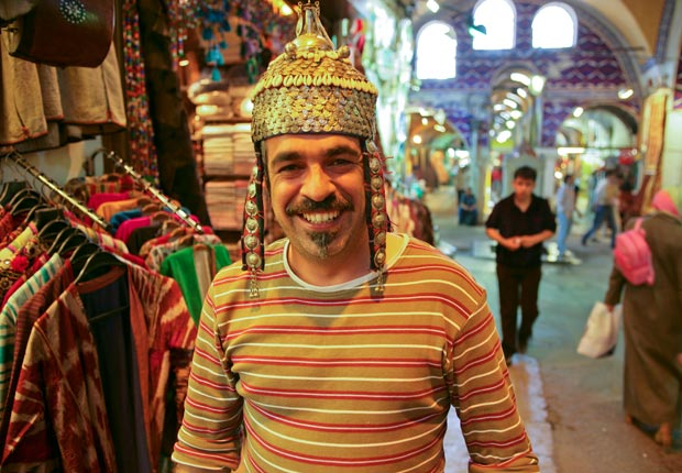 Man wearing hat at Grand Bazaar, Instanbul, Turkey,     Frommers: 10 Must-Do Overseas Trips