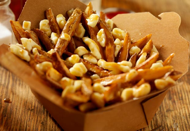 Poutine consisting of French fries, cheese curd, and gravy, Montreal, Canada