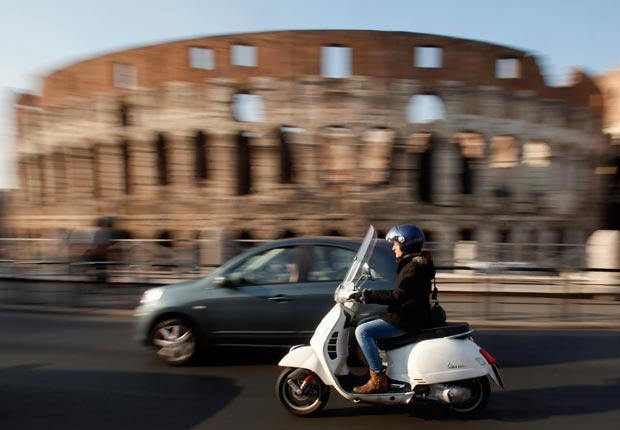 Scooter in front of Colosseum, Rome, Italy
