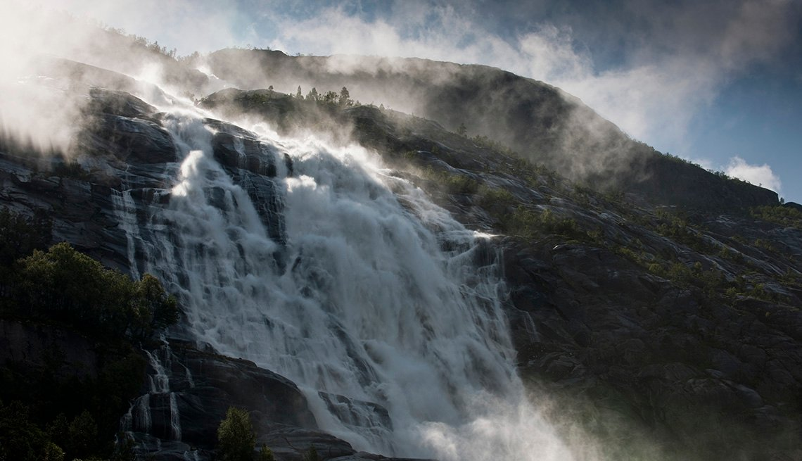 View Of The Mist Over The Ridge And Waterfall Of Langfoss In Norway, Best International Waterfalls