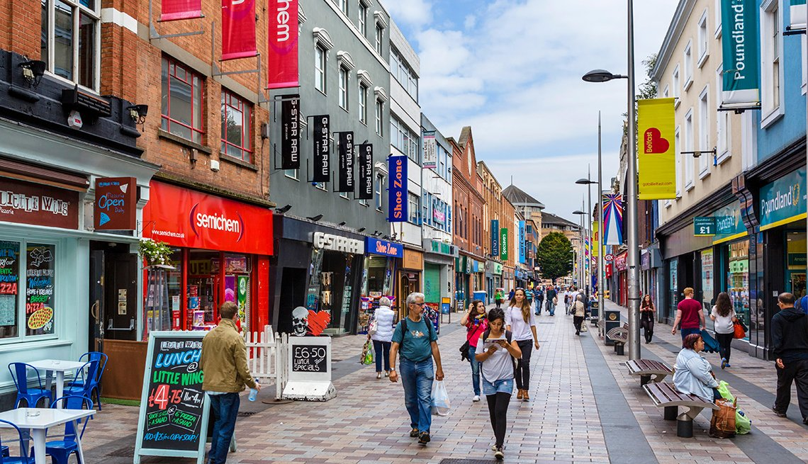 Pedestrians Stroll Past Shops and Cafes in Belfast, Northern Ireland, Top International Destinations