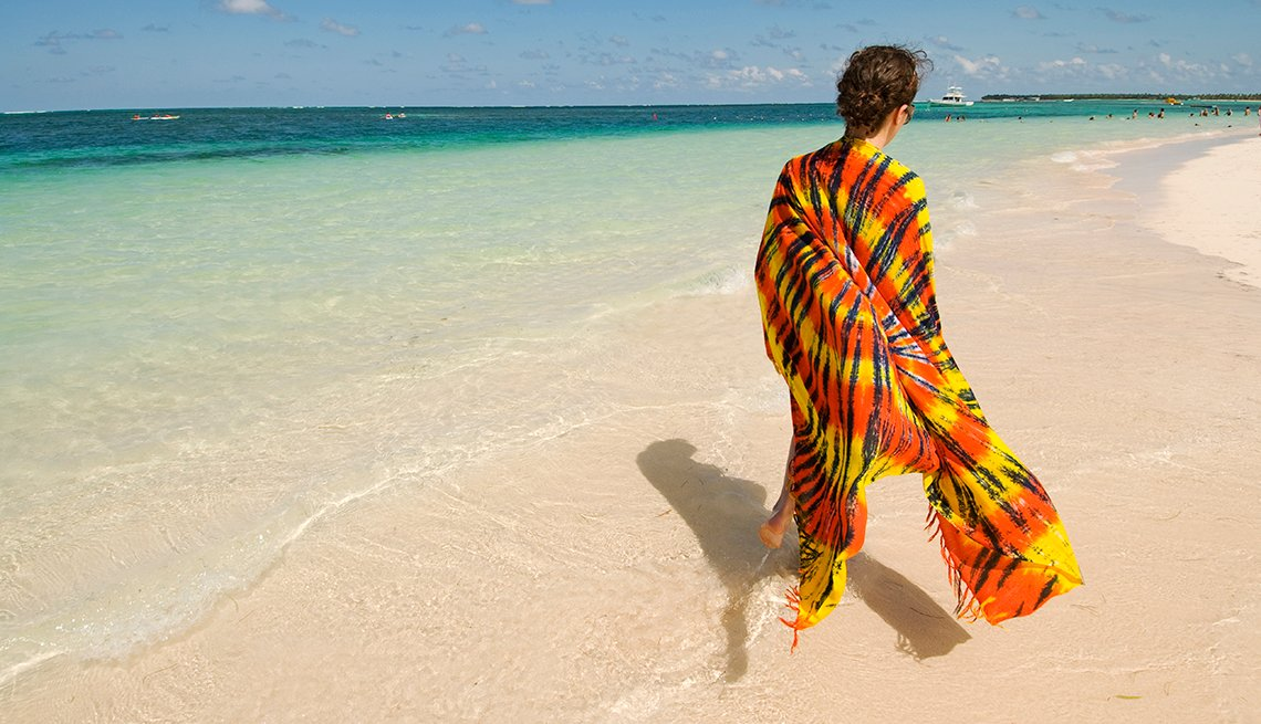 Woman on Tropical Beach, Colorful Wrap, World's Best Budget Places