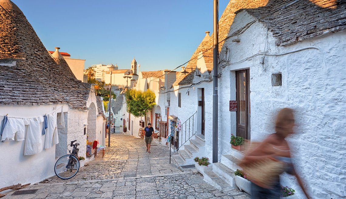 Pedestrians on a street in Apulia region of Italy, International Bucket List Destinations