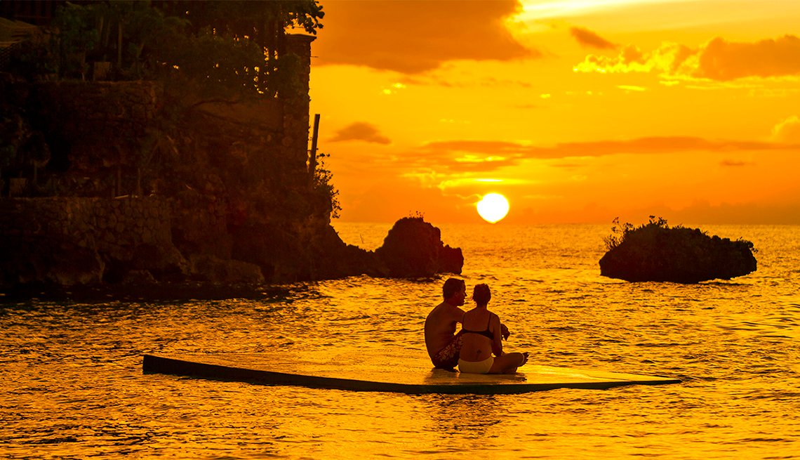 Couple Watching Sunset off Ocho Rios, Jamaica, Caribbean Island Guide