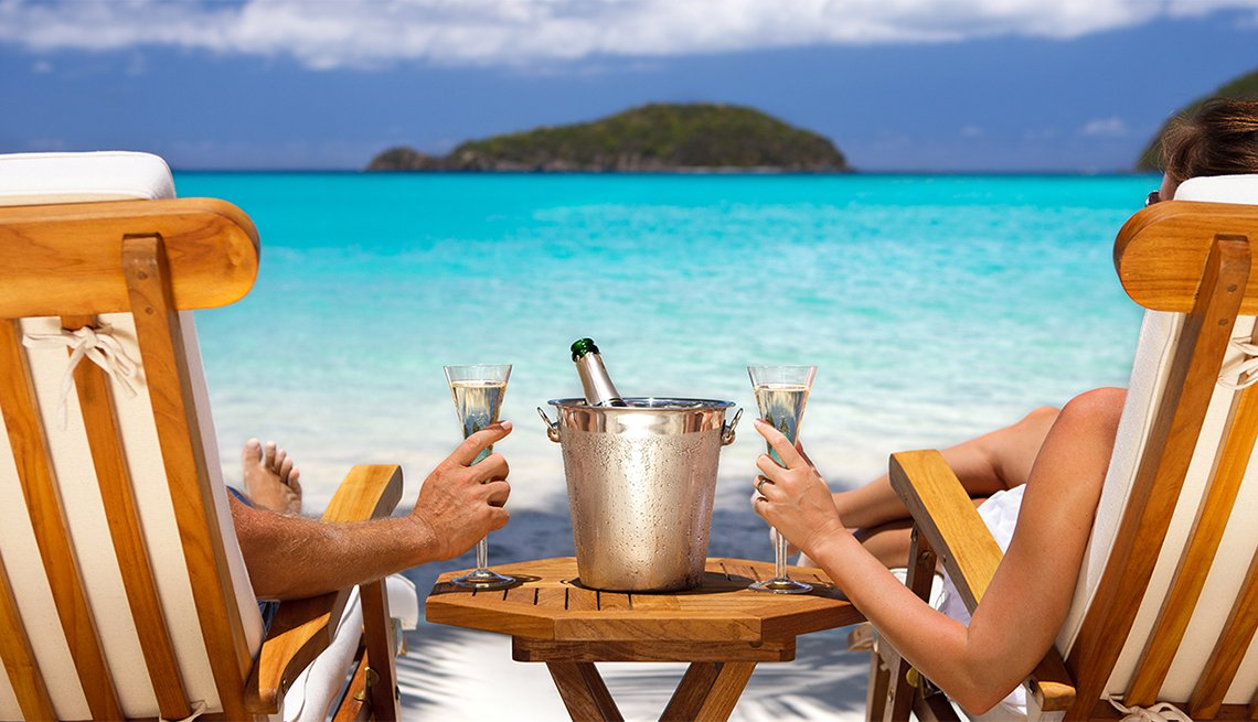 Couple in Recliners Enjoying Champagne on Beach, Caribbean Island Guide