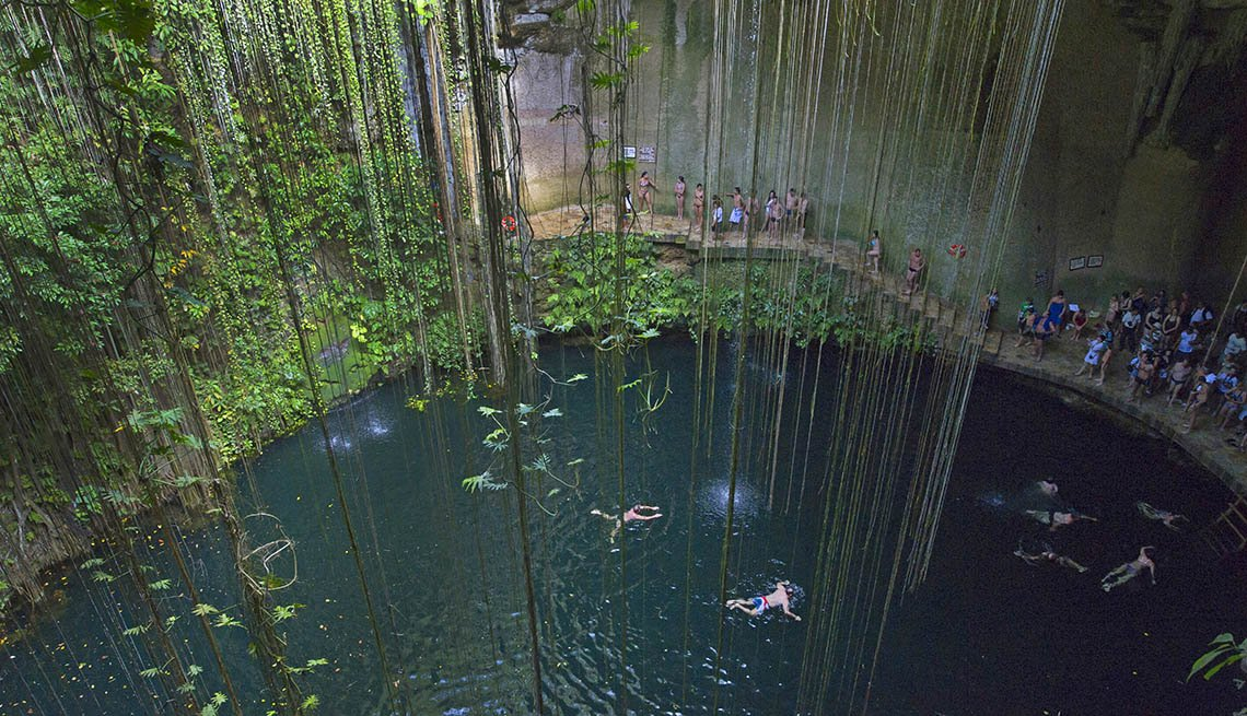 Swimmers And Tourists Enjoy A Cenote In The Mexican Wilderness, Latin American Natural Wonders