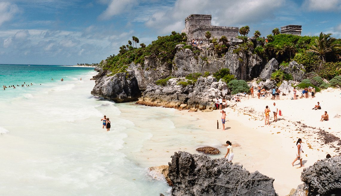 Beachgoers at the Tulum Mayan ruins, Mexican Getaways, Travel