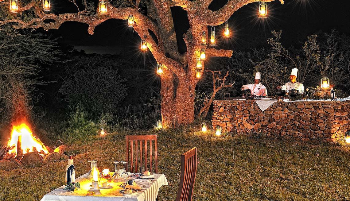 Chefs Prepare A Meal Outdoors At The Serengeti Migration Camp In Tanzania, Global Glamping