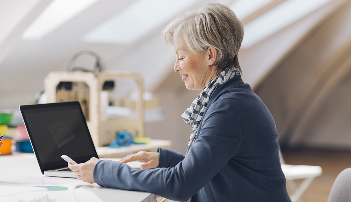 Mature Caucasian Woman with Laptop and Credit Card, Checklist for International Travel