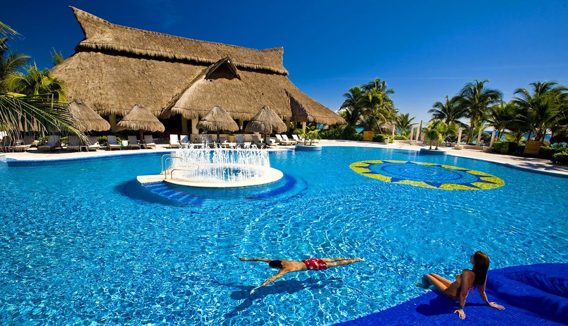 Hotel Guests Enjoy The Pool At Catalonia Royal Tulum, All Inclusive Mexican Resorts