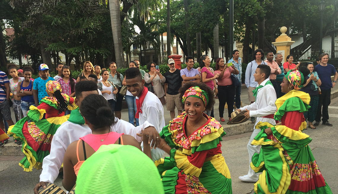 Ladies In Colorful Dress Dance In The Street, Colombia Slideshow
