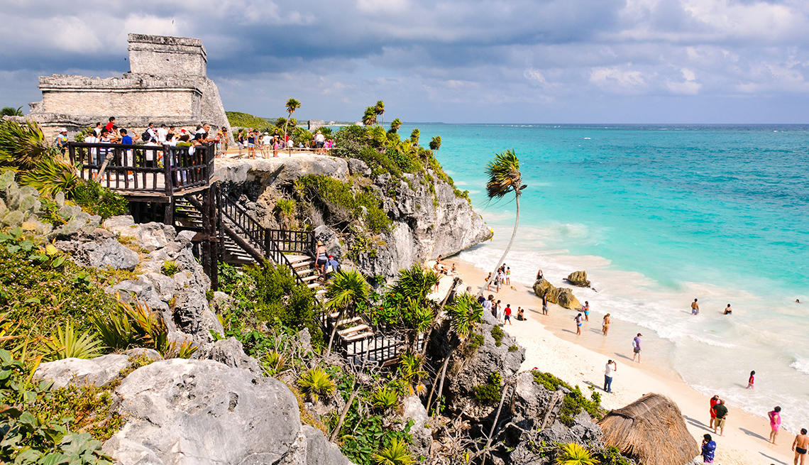 Tourists Walk On The Beach Near The Ruins Of Tulum, All Inclusive Mexican Resorts