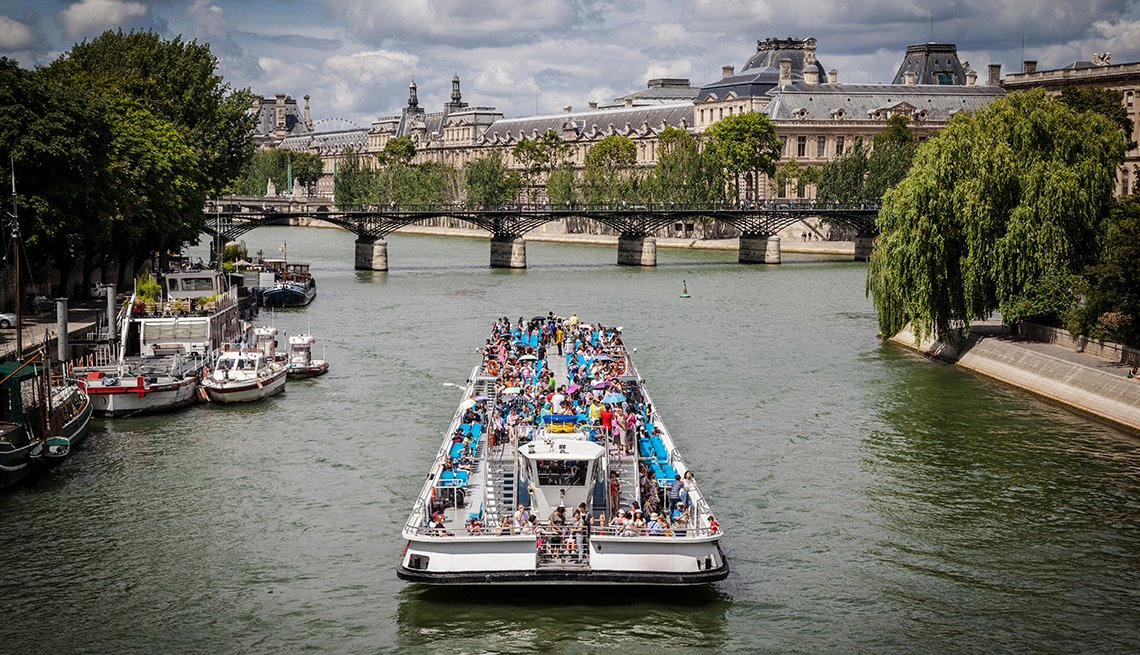 Touristic ships passing on Siene river in Paris, France