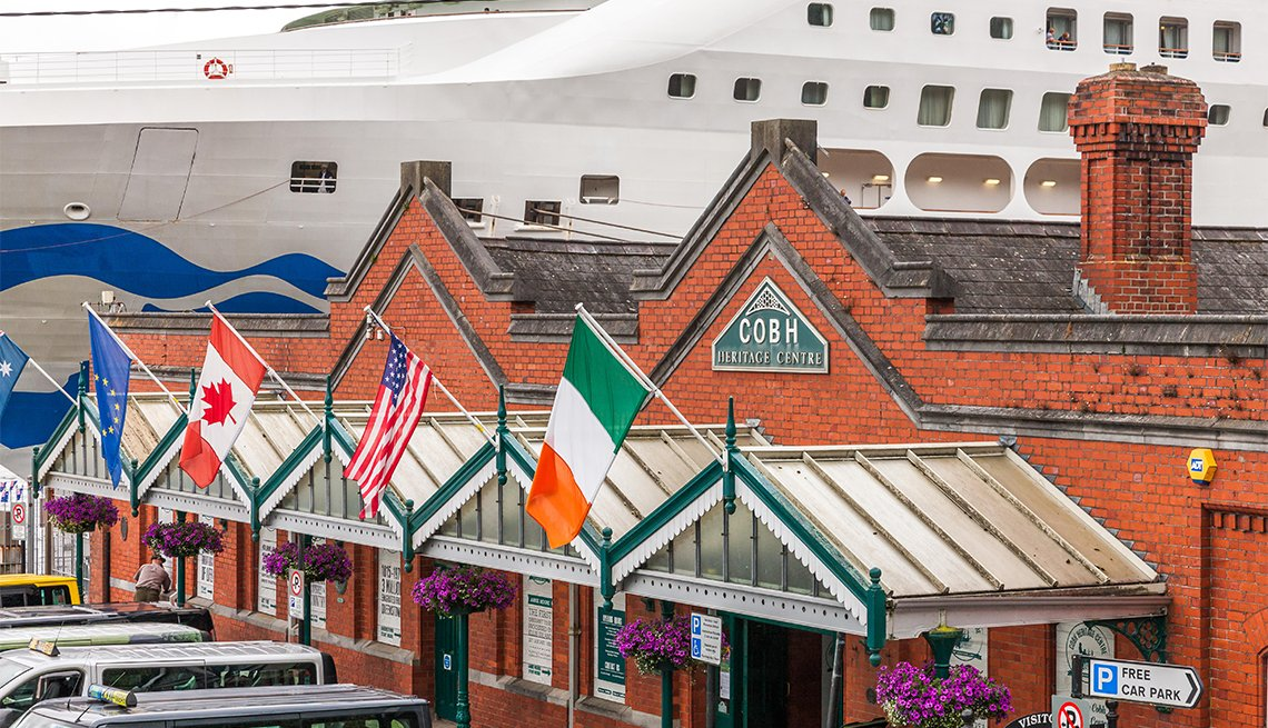 The heritage centre on the sea front with the cruise ship Sea Princess docked at the quayside in Cobh, Co. Cork, Ireland. Credit: David Creedon/Alamy Live News