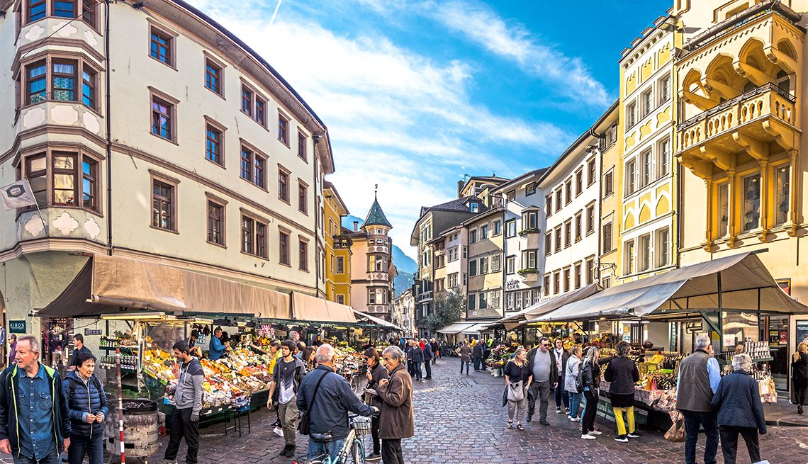 People shopping at a famous Market Square in the old town in Bolzano, Italy