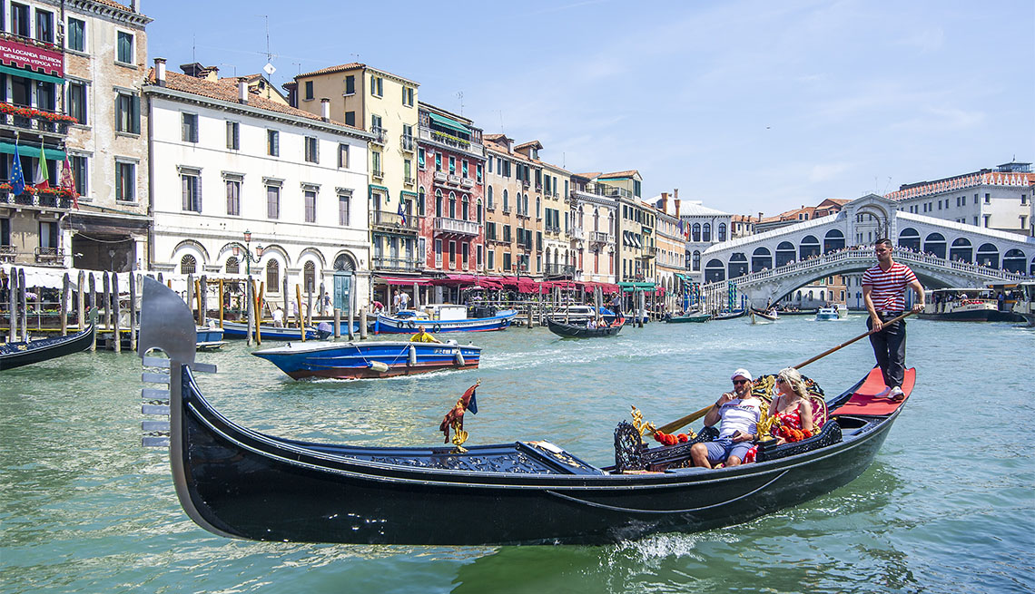Tourists enjoy a gondola ride on June 12, 2021 in Venice, Italy