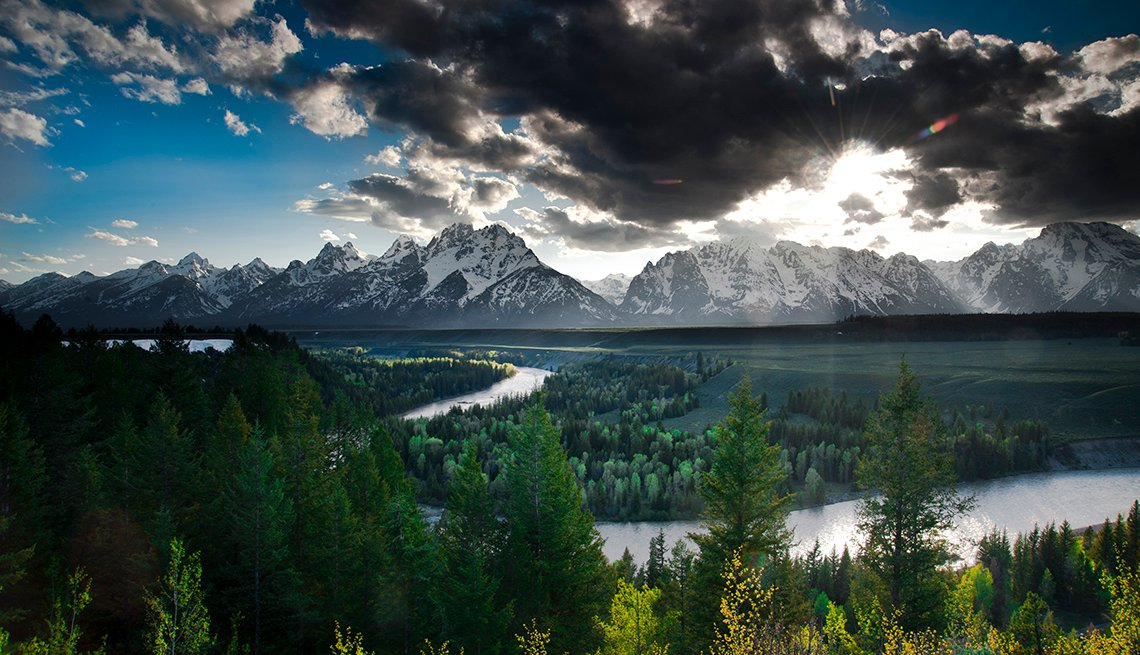 Sun in Clouds, River in Trees, Snow Capped Teton Range, America's Top 10 Natural Wonders