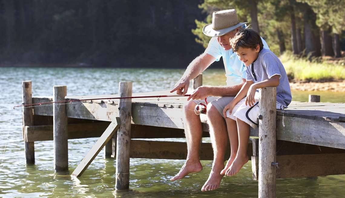 Grandfather Teaches His Grandson To Fish On The Dock By The Lake, Best Fishing And Boating Spots In USA
