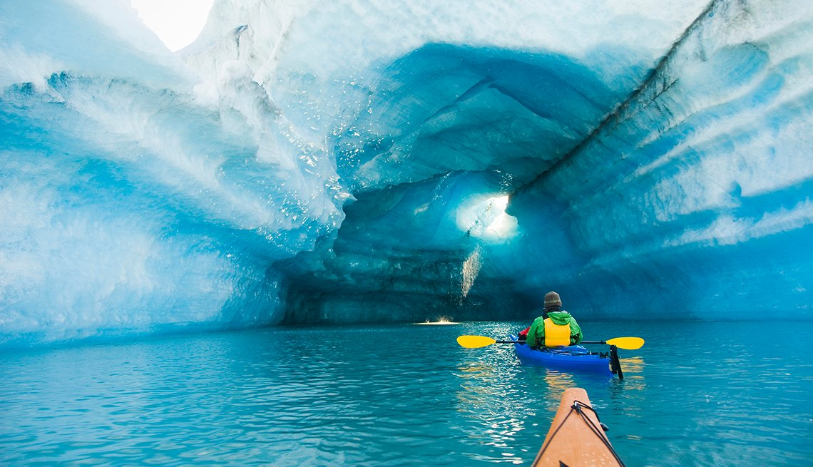 Kayaks Under Blue Iceberg, College Fjord, Alaska, Popular Tourist Attractions in America