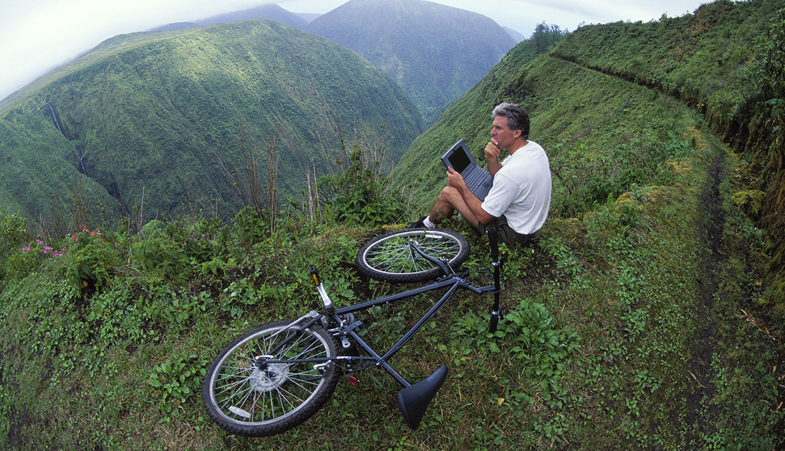 Man On Mountain Looking Around Bicycle The Ground Hidden Locations To Visit In