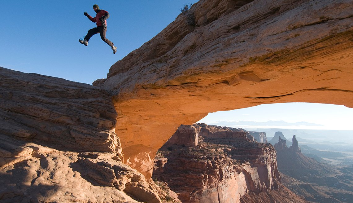 Man Leaping Red Arch, Moab Valley, Popular Tourist Attractions in America