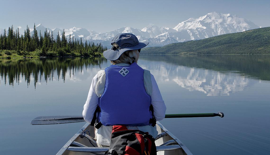 Woman Canoe, Reflections, Denali National Park, America's Top 10 Natural Wonders