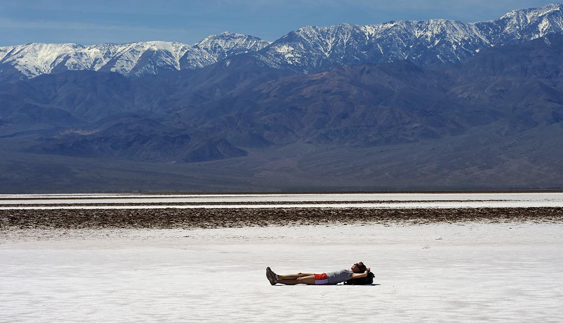 Erinn Deshinsky, Woman Lying on Salt Flats, Snow on Mountains, America's Top 10 Natural Wonders