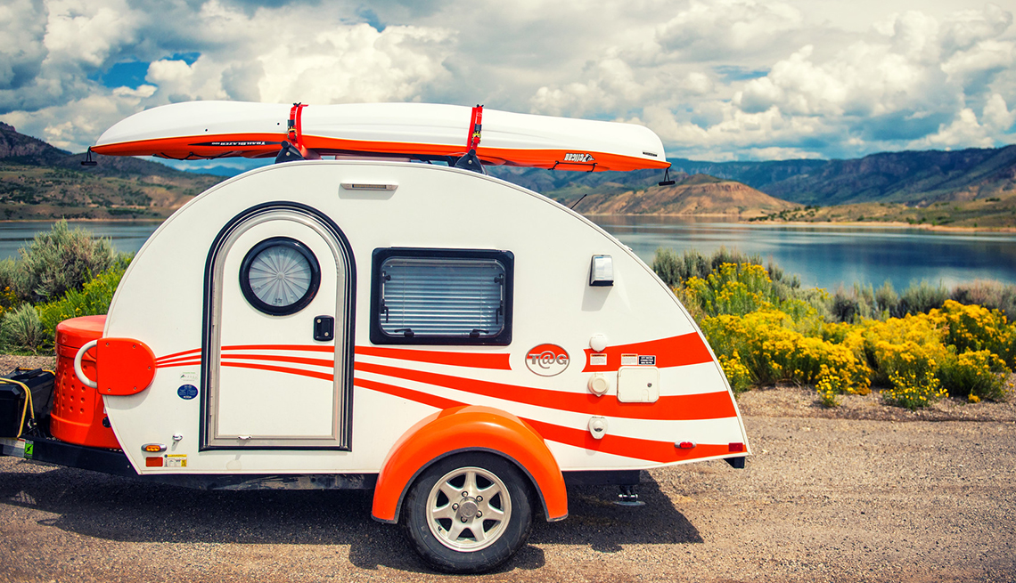 Teardrop Trailer with Kayak Parked by Mountain Lake, Teardrop Campers Make Comeback