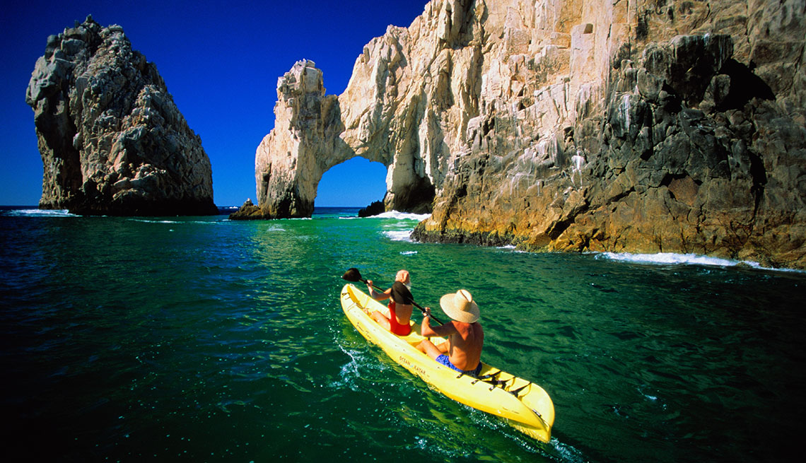Two Women In Kayak In Bay In Cabo San Lucas Near Baja Mexico, Sunny Holidays