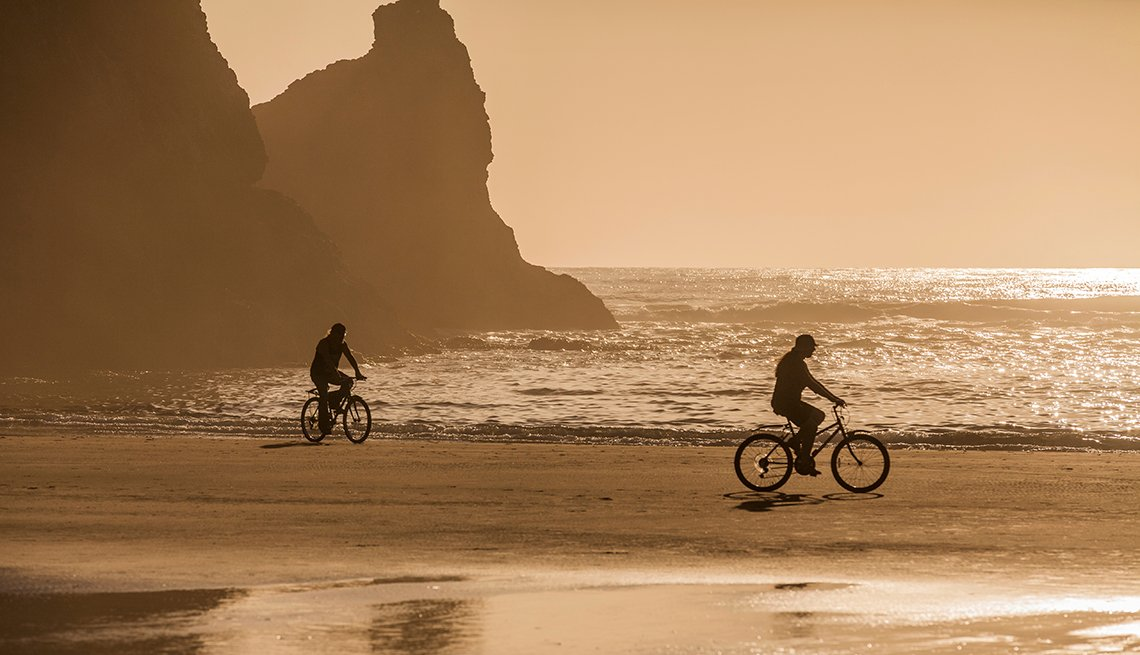 Couple Riding on Beach, Sunset Rocks, Gold Light, Budget-Friendly Travel Ideas