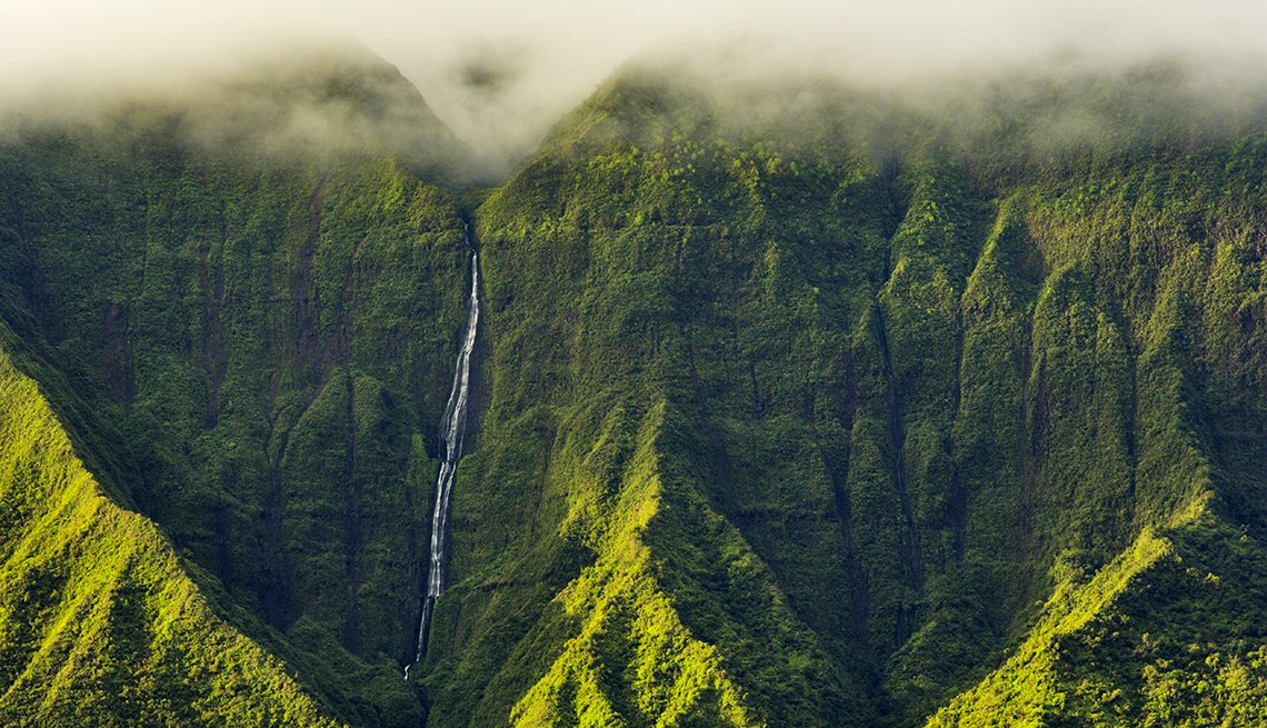 Clouds over Mountains with Waterfall in Kauai, Hawaii, United States Bucket List Destinations