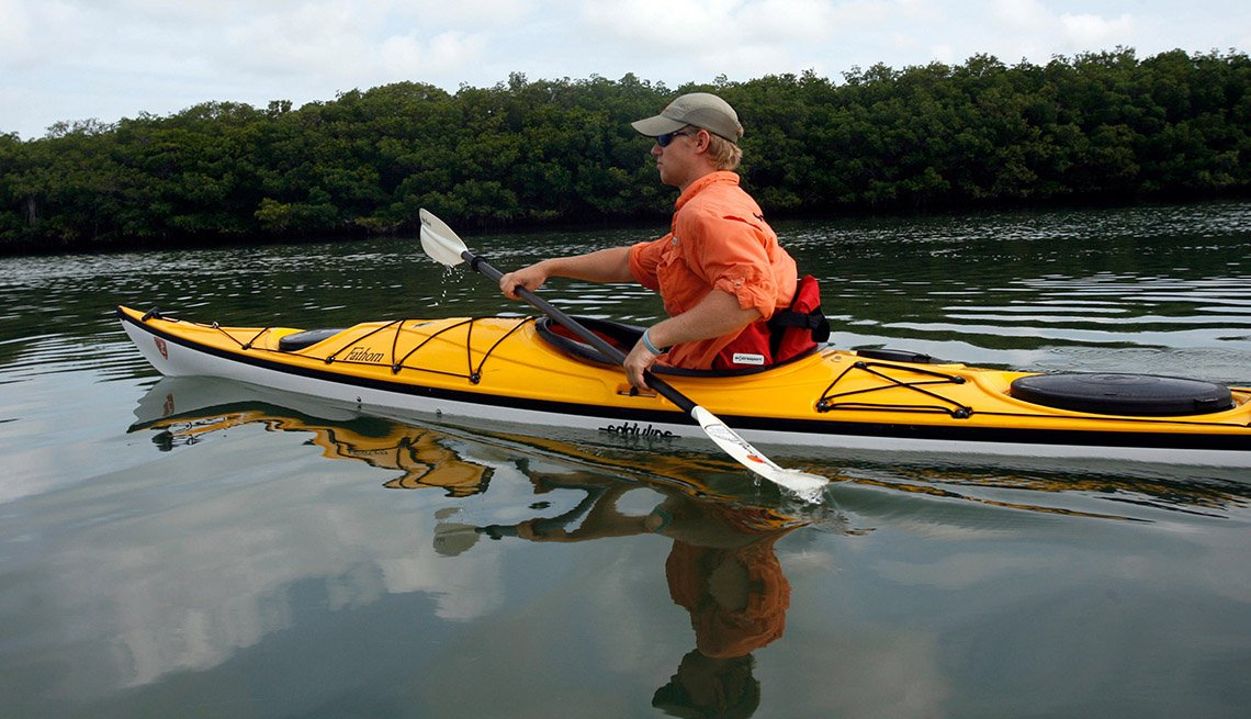 Caucasian Man Kayaks On Caladesi Islannd In Florida, Secluded Beaches