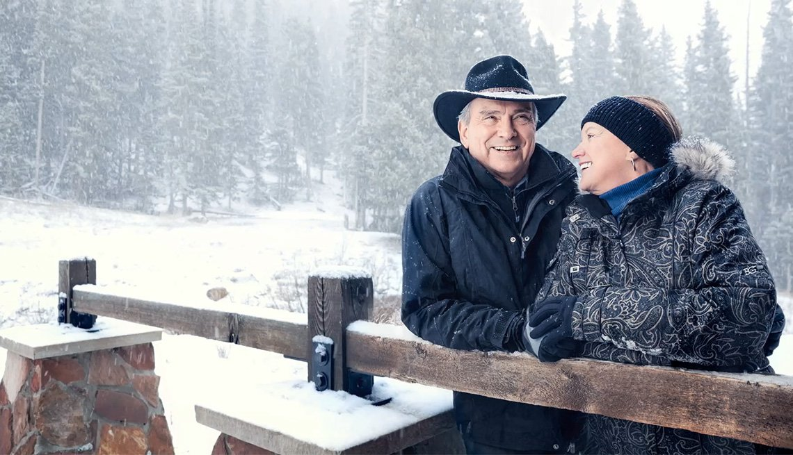 Middle Aged Caucasian Couple In Snow, National Parks Bucket List