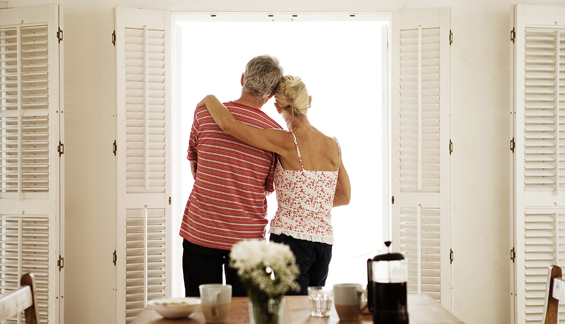 Caucasian Couple Lookng Out Window, Breakfast Table, Hotel Alternatives, Budget-Friendly Travel Ideas