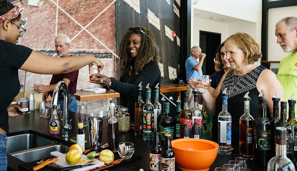African-American Bartender Serves Whiskey Bar, Louisville, Heartland Getaways