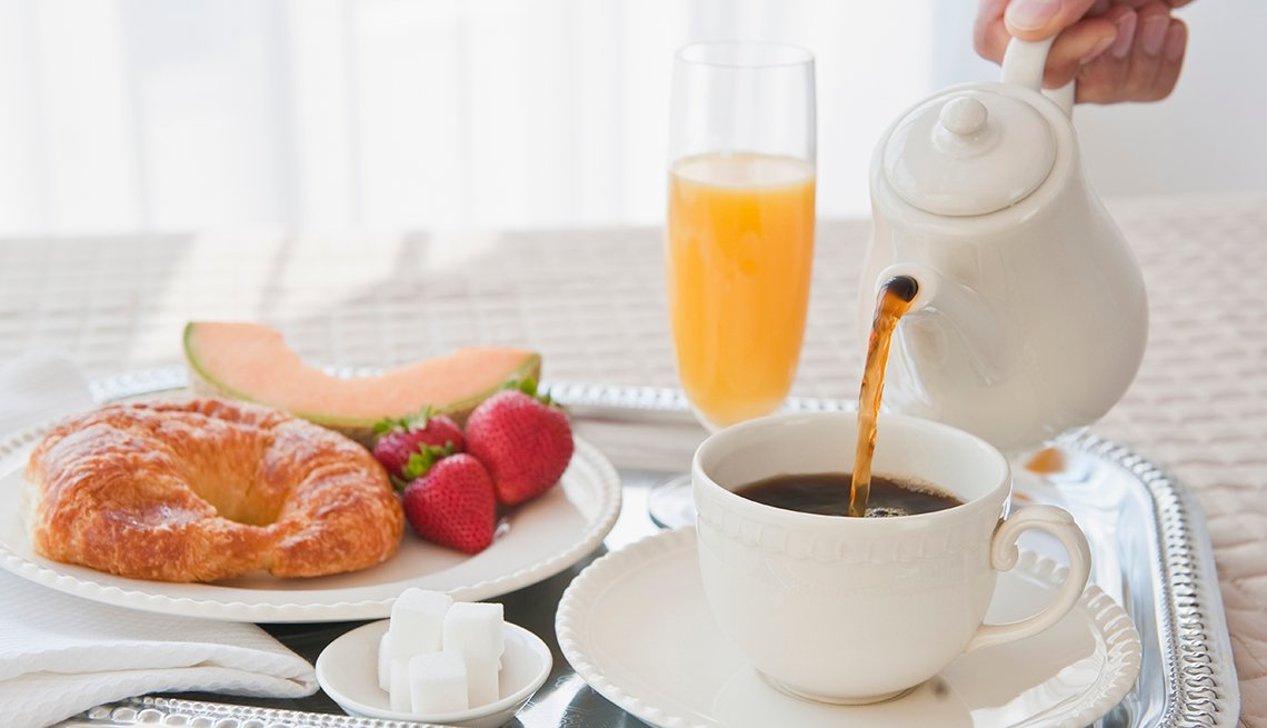 Breakfast Tray with Croissant, Fruit, Orange Juice and Hot Coffee, Hotel Chains Free Breakfast