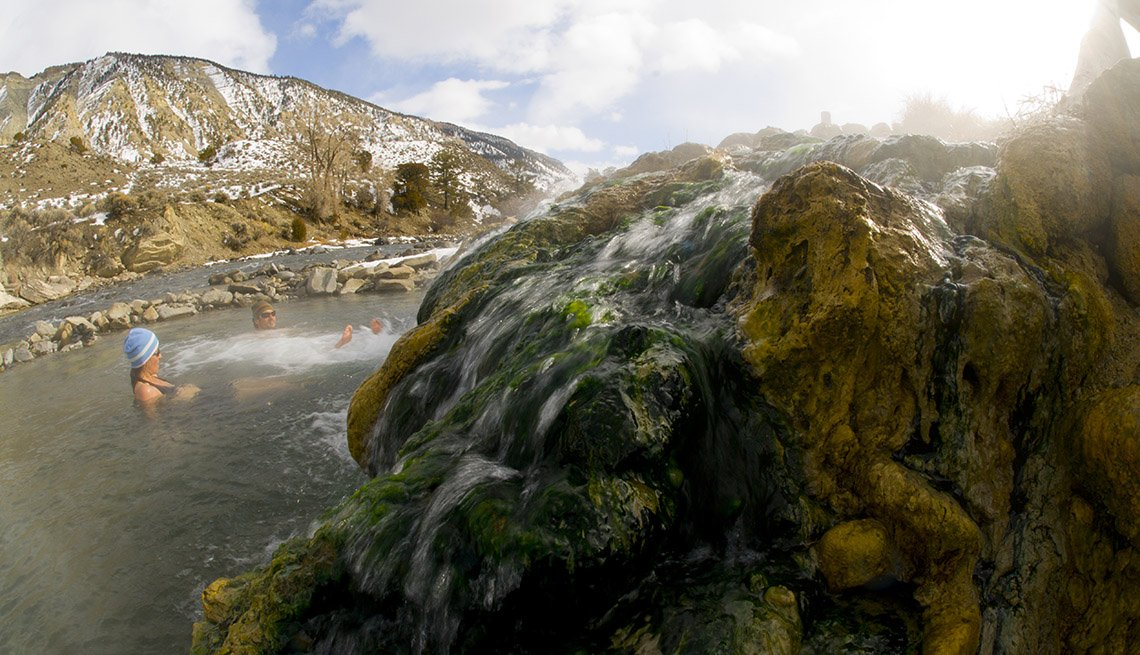 People Enjoy The Hot Springs In Yellowstone National Park In Wyoming, National Parks Experiences