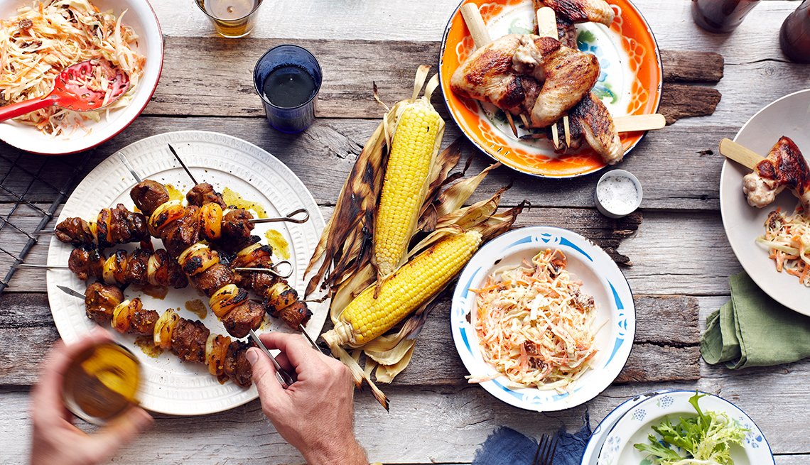 Grilled Meat on Skewer, Roasted Ears of Corn, Top U.S. Cities for Foodies