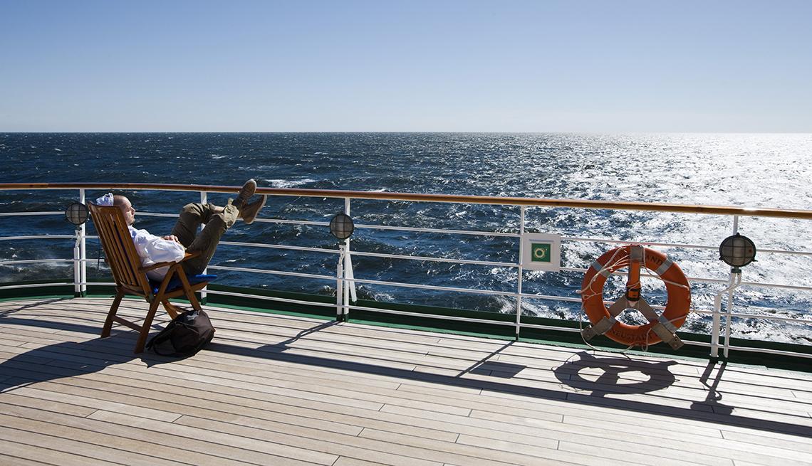 Man in Deckchair, Sun on the Ocean, Repositing Cruise, Budget-Friendly Travel Ideas