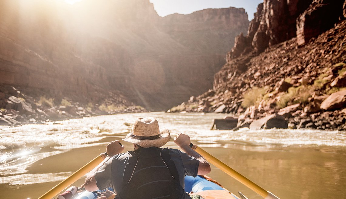 Man Goes White Water Rafting In The Colorado River In The Grand Canyon, National Parks Experiences