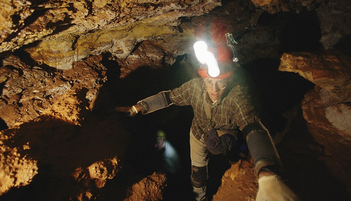 Man With Helmet Light Goes Spelunking In The Black Hills Of South Dakota, National Parks Experiences