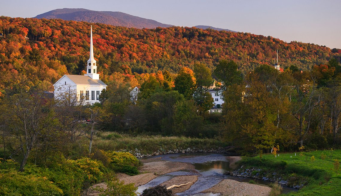 item 10, Gallery image. A white church contrasts with colorful leaves on mountain trees.at Stowe, Vermont. Covered bridges in the vivid colors of autumn makes for a stunning autumn trip to the mountains of Vermont.