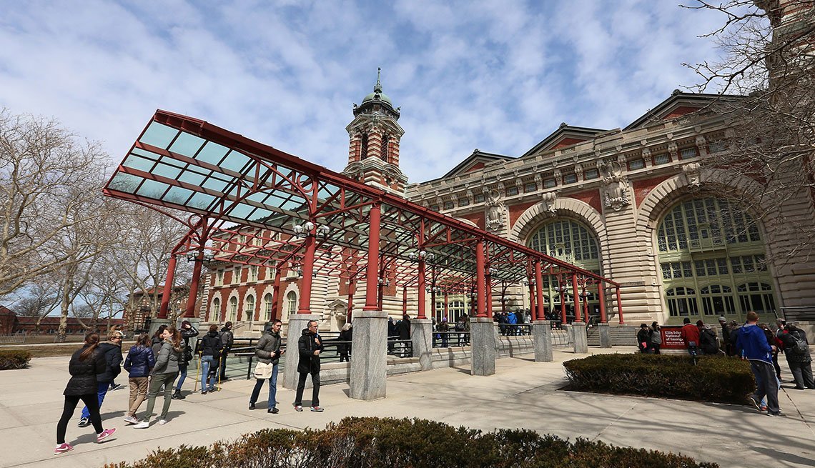 Visitors Outside The Exterior To The Museum On Ellis Island, Reasons To Visit Ellis Island