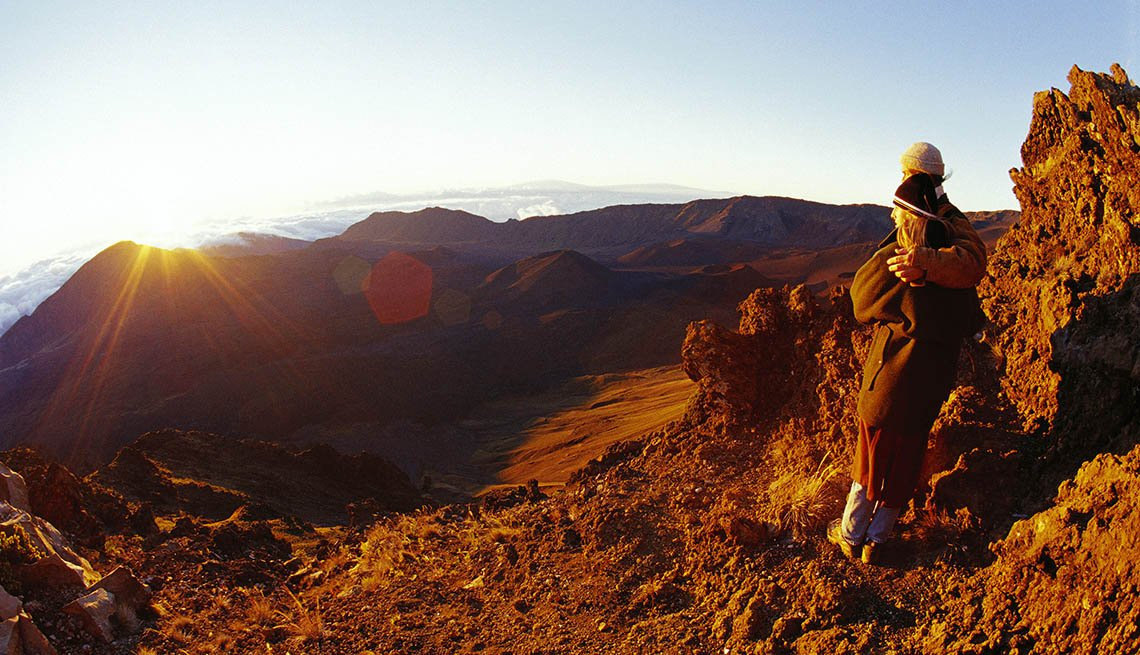 Hiker Enjoys The Sunrise On Hawaii's Maui Haleakala Crater, National Parks Experiences