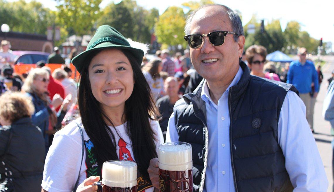 Asian Man And Woman Enjoy Beers At The New Ulm Oktoberfest, Oktoberfest Destinations USA