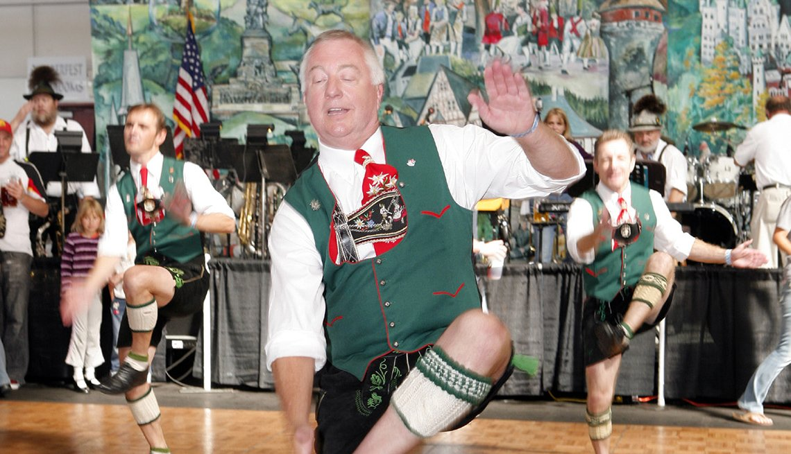 Man Dancing In Traditional German Clothes, Oktoberfest Destinations USA